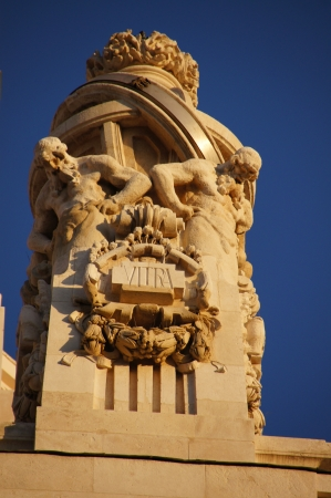 atlantes: Atlantes sculptures on the covers of the main entrance of the palace of communications, town hall, Madrid, Spain Stock Photo