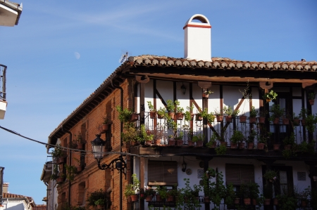 fireplaces: Typical house of brick with visible structure of wood, roof of Arabic tiles, brick fireplaces, sherds and flowers, wooden galleries, typical spanish lanterns, dishes and ceramic tiles, cane blinds, Candeleda, Spain