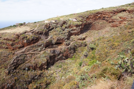 volcanic landscape: Volcanic landscape, typical houses, wild vegetation, mountain roads, prickly pears, dragos, sea and sky and people of Santo Domingo, La Palma, Canary Islands, Spain