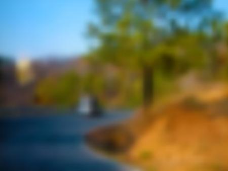 Road blurred background with blue, orange, green and turquoise road turn texture, in vector