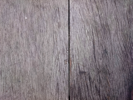 Abstract grey wooden texture. Gray weathered wood with gap between two parts. Brown vertical timber boards with old scratched pattern. Foto de archivo