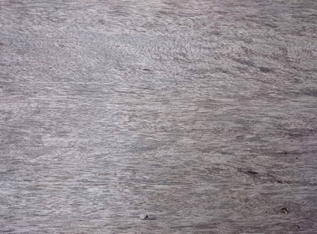 Abstract grey wooden texture. Gray weathered wood. Brown horizontal timber board with smooth uniform pattern.