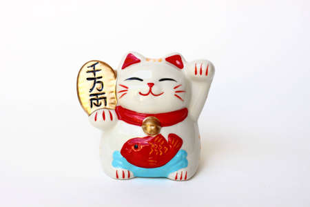 luck: Japanese lucky cat on white