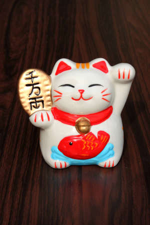 good luck: Japanese lucky cat Stock Photo