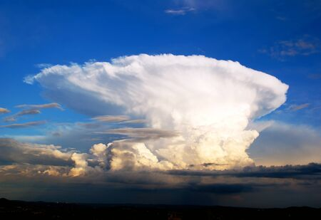 Big cumulonimbus in the sky blue.