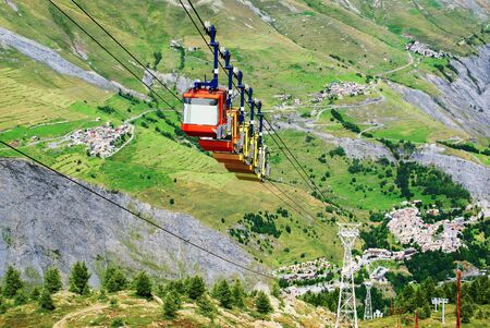 Cable car climbing in the French Alps.