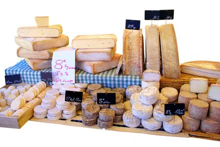 Stall of different cheeses at the market on a white background.