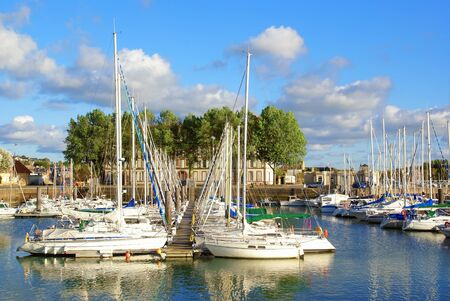 Sailboats moored at the marina of Deauville in Normandy, France.
