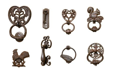 Series of ornate door knockers, isolated on white background.