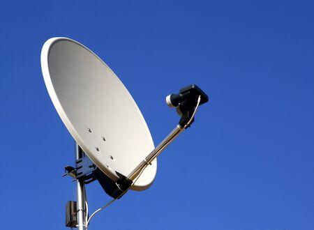 Satellite dish on blue sky background Foto de archivo