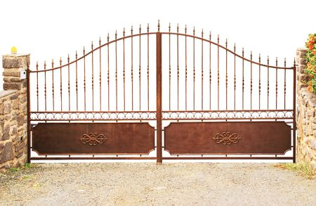 Rust colored metal gate isolated on white background. Stock Photo