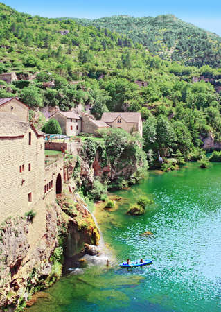 The river Tarn at the village waterfall of Saint-Chély-du-Tarn.
