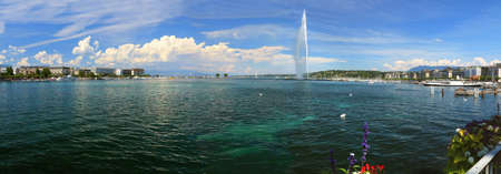 The famous Geneva water jet against a background of sky with summer clouds.