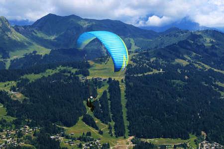 Practice paragliding in a mountain environment.