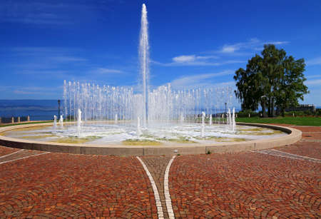 Water jet and basin in Thonon-les-Bains, on the shores of Lake Geneva.