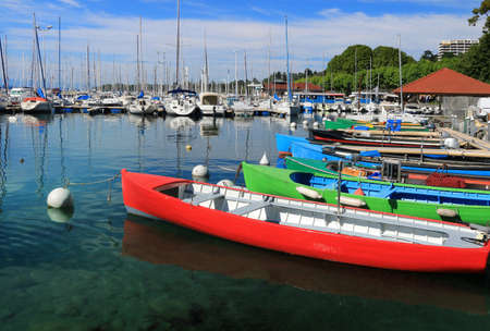 Multicolored boats, in bright colors, moored in a marina.