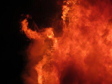 Buergbrennen festival in Luxembourg: celebrating end of winter by burning mock castles. Big bonfire on black background