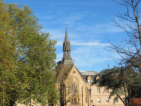 Chapel tower neo gothic style of senior home Fondacion Pescatore in Luxembourg in autumn sunshine Stock Photo