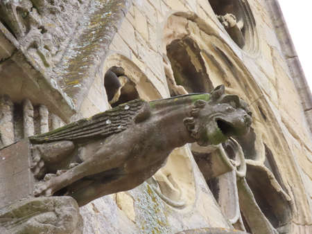 Sphinx gargoyle of gothic Cathedral in Bayeux, Normandy, France. Close up Stock Photo