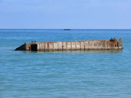 Part of temporary D-day port in Arromanches, Normandy, France. Concrete structure during high tide