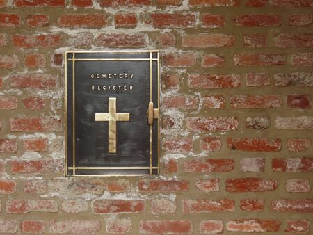 Closed black metal box in red brick wall of each military cemetery containing a register book with names of buried and another for visitors to sign Zdjęcie Seryjne