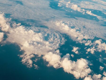 Small cloud vortex view from above, real photo from plane with enhanced colours to distinguish it better