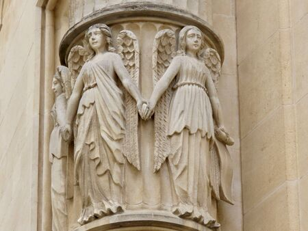 Medieval sandstone relief of 3 young female angels holding hands, found on Grand Duke palace wall corner in Luxembourg old town Archivio Fotografico