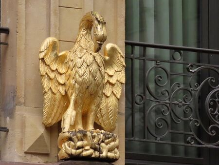 Figure of golden pelican with chick in nest as a decorative detail on a historic house in Luxembourg old town