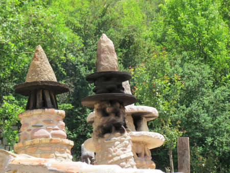 Traditional chimneys in Pyrenees, Basque country, Spain: cone shaped beige stone structures with marks from sod and smoke