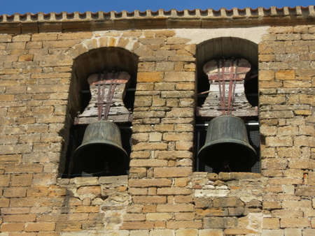 Two bells with counterweights in bell tower, rough stone wall, rural look, church of St. Nicholas of Bari, Larrasoana, Navarra, Spain