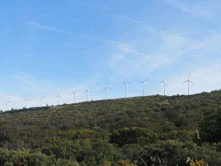 Wind power generator turbines on a green mountain in Spain