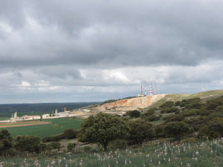 Sierra de Atapuerca by Burgos, in Castile and Leon, northern Spain. Modern communication towers and asphodel flowers