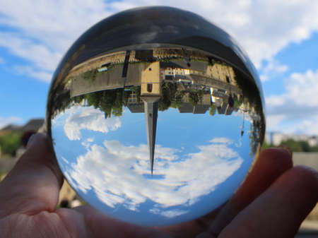 Neumunster Abbey in Luxembourg Grund through crystal ball, blurry background, on a sunny summer day