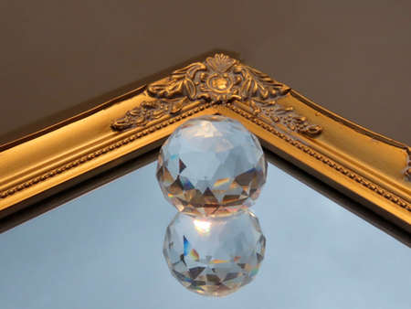 Prism crystal ball on mirror with gold baroque frame