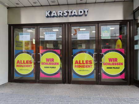 Karstadt shopping mall closing signs saying in German All reduced prices and We are closing this branch in Trier, Germany - September 3, 2020