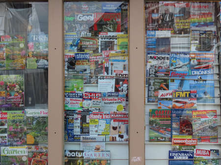 Kiosk window with various German magazines in Trier, Rhineland-Palatinate, Germany - September 1, 2020