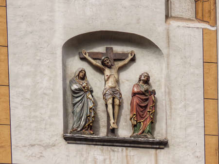 Medieval Crucifix in Trier. Jesus on cross and mourning mother Mary and Saint John