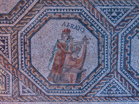 Erato - one of 9 muses portrayed in medalion with geometric ornamented borders. The Roman floor mosaic is freely accessible for everybody outdoors in Vitchen, Luxembourg Stock fotó