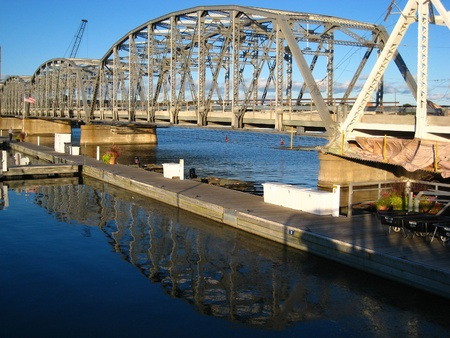 sturgeon: The lacy structure of a draw bridge reflects in the water beneath it in Sturgeon Bay, Wis.