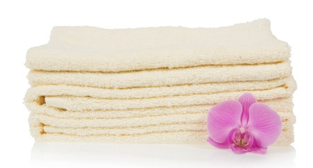 The bathing towels decorated with a flower of an orchid, isolated on white photo