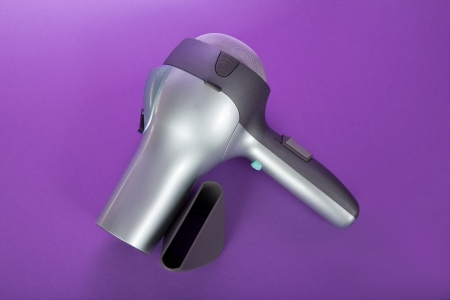air diffuser: The hair dryer for drying of hair and additional accessories, on the violet Stock Photo