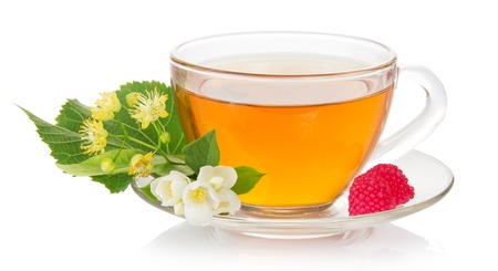 Cup of tea with a saucer, jasmine and linden flower, raspberry isolated on white photo