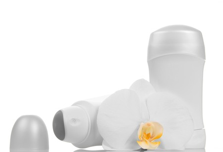 armpits: Empty bottles of deodorants and orchid flower isolated on white background.