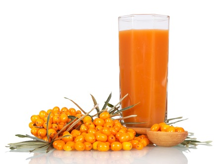 argousier: Seabuckthorn, a spoon with berries and a glass of juice isolated on white background.
