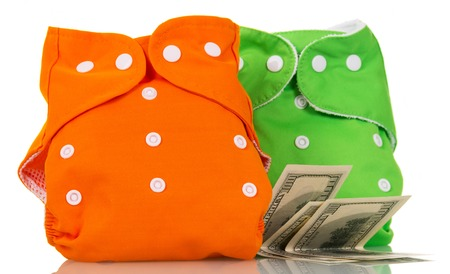 Modern eco-friendly diapers and money, isolated on white background. Stock Photo