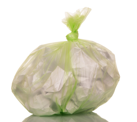 get away: A plastic bag with trash isolated on white background.