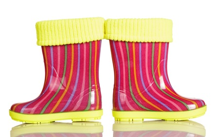 Children rubber boots with fabric inset isolated on white background.