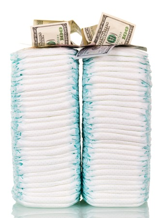 incontinence: Stacks of diapers and dollars isolated on a white background.