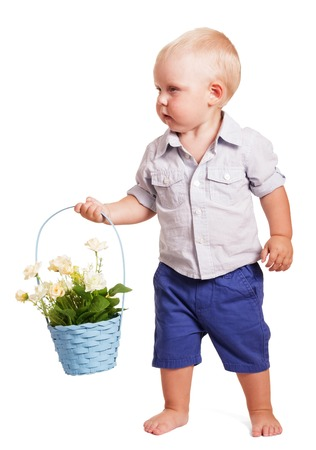 strip shirt: Little boy in bright striped shirt and blue shorts standing and holding a basket with roses isolated on white background.