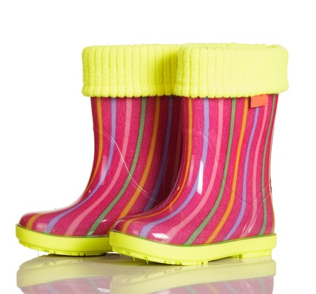 inset: Children rubber boots with fabric inset for walking in the rain and after isolated on a white background.